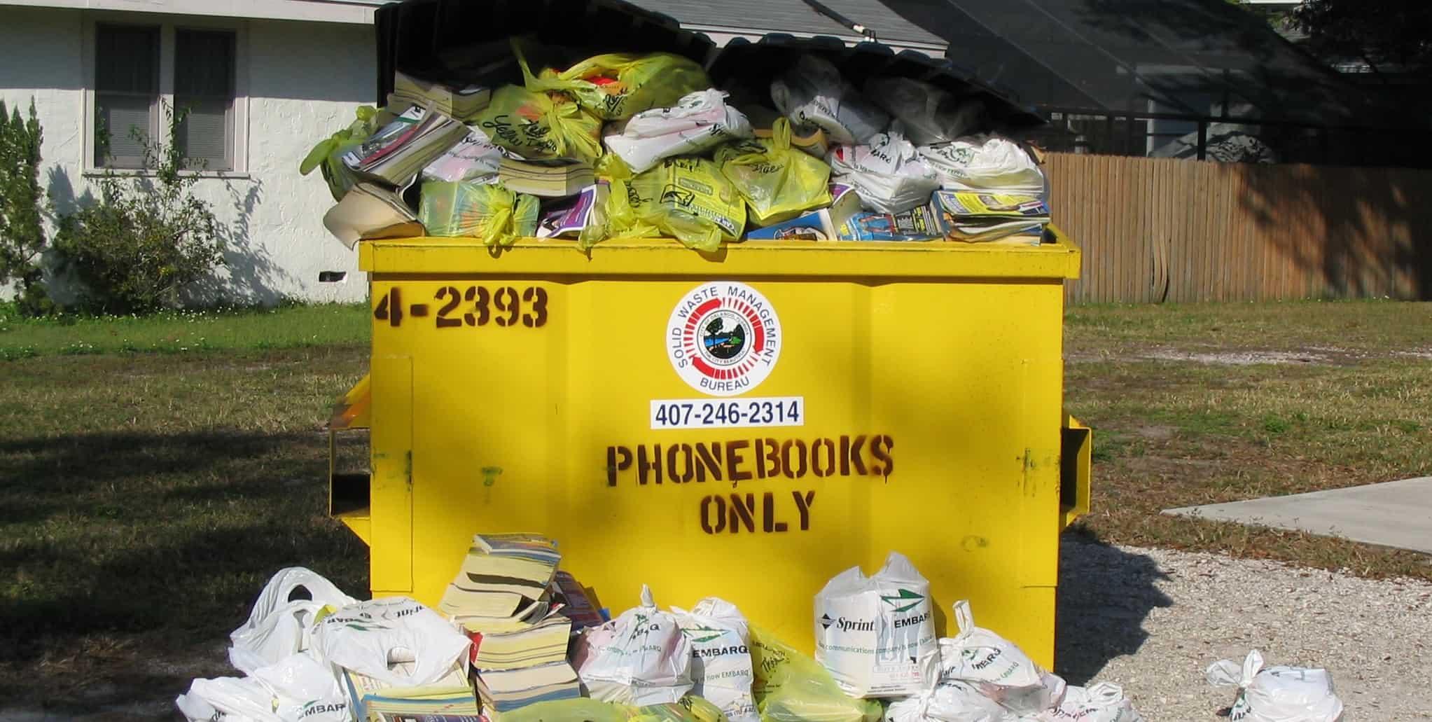 Phonebooks in dumpster