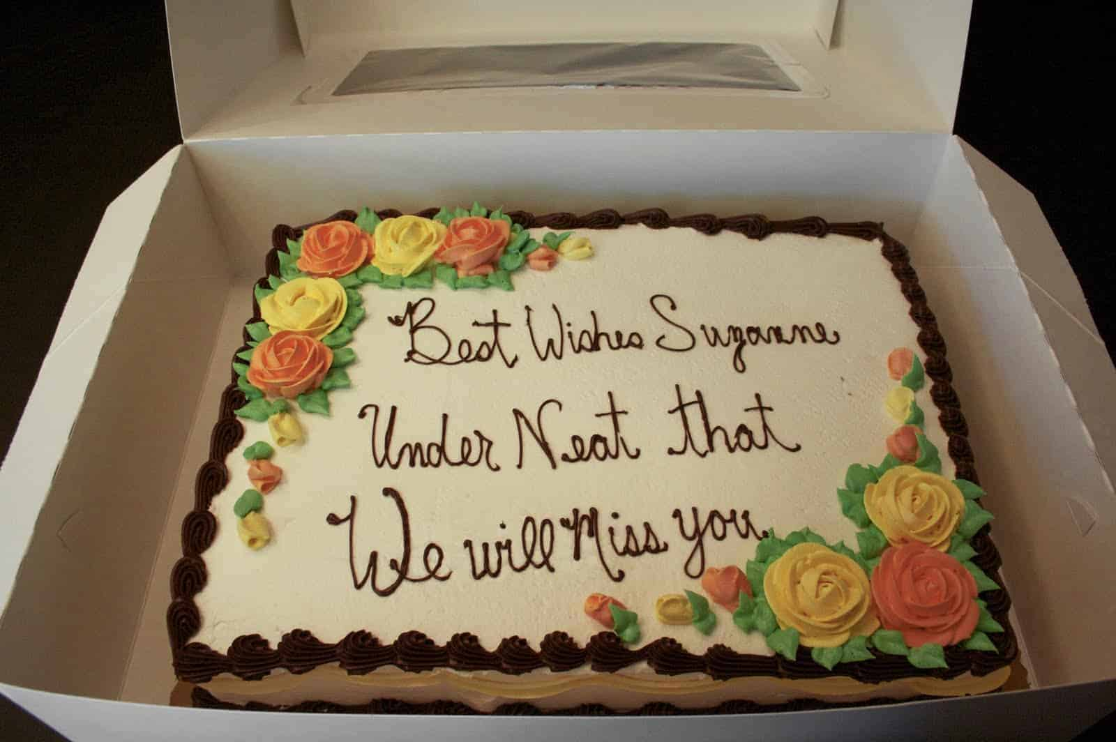 "Cake decorated with, ""Best Wishes Suzanne, Under Neat that, We will miss you"""